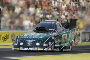 Photo - In this photo provided by NHRA, John Force drives in Funny Car qualifying Saturday, Aug. 2, 2014, at the O'Reilly Auto Parts NHRA Northwest Nationals drag races at Pacific Raceways in Kent, Wash. Force took the top spot with a run of 4.057 seconds at 308.07 mph. (AP Photo/NHRA, Jerry Foss)
