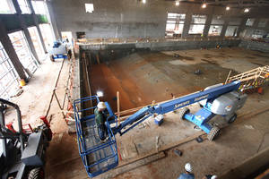 Photo - Construction on the Edmond Recreation and Aquatic Center is about 75 percent. Completion may be delayed because of a design problem with the leisure pool deck. PHOTO BY PAUL HELLSTERN, THE OKLAHOMAN. <strong>PAUL HELLSTERN - OKLAHOMAN</strong>