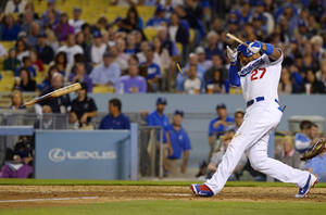 Photo - Los Angeles Dodgers' Matt Kemp breaks his bat as he flies out during the fourth inning of a baseball game against the Colorado Rockies, Friday, Sept. 27, 2013, in Los Angeles. (AP Photo/Mark J. Terrill)