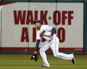 Photo -   Cleveland Indians center fielder Michael Brantley fields a single hit by Chicago White Sox's Kevin Youkilis in the ninth inning of a baseball game, Monday, Oct. 1, 2012, in Cleveland. The White Sox won 11-0. (AP Photo/Tony Dejak)