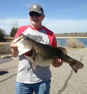 Photo - J.D. Kent of Durant with a 13.86-pound largemouth bass that he caught at Arbuckle Lake last weekend.Photo provided