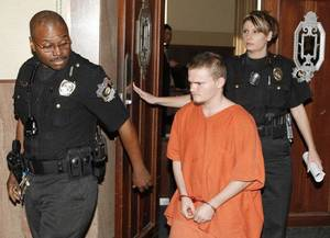 Photo - Mark Anthony Richardson II is escorted from a courtroom in January after his preliminary hearing. Photo by Steve Gooch, The Oklahoman  <strong>Steve Gooch</strong>