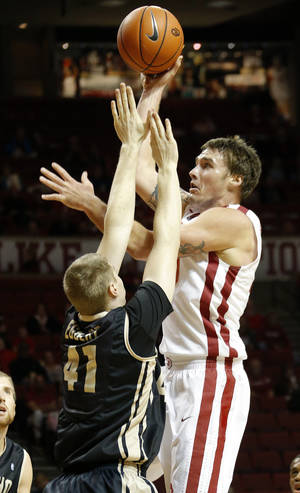 Photo - Oklahoma's Ryan Spangler puts up a shot over Idaho's Ty Egbert (41) during a college basketball game between the University of Oklahoma Sooners and the Idaho Vandals at Lloyd Noble Center in Norman, Okla., on Wednesday, Nov. 13, 2013. Wednesday, Nov. 13, 2013. Photo by Bryan Terry, The Oklahoman