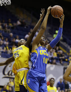 photo - UCLA forward Kacy Swain, right, gets the ball away from California forward Gennifer Brandon, left, during the first half of their NCAA college basketball game on Sunday, Jan. 20, 2013, in Berkeley, Calif. (AP Photo/Eric Risberg)