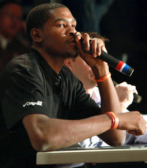 Photo - Thunder star Kevin Durant makes comments during filming of the Degree Men Alley-Oop Challenge at the Santa Fe Family Life Center. PHOTO BY JOHN CLANTON, THE OKLAHOMAN