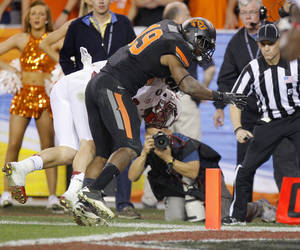 photo - Oklahoma State&#039;s Brodrick Brown (19) stops Stanford&#039;s Griff Whalen (17) short of the end zone during the Fiesta Bowl between the Oklahoma State University Cowboys (OSU) and the Stanford Cardinal at the University of Phoenix Stadium in Glendale, Ariz., Monday, Jan. 2, 2012. Photo by Bryan Terry, The Oklahoman