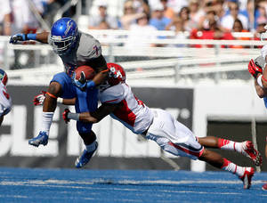 Photo -   Boise State running back D.J. Harper gains yards on a run before being hit by Fresno State defensive back L.J. Jones during and NCAA college football game Saturday Oct. 13, 2012 in Boise, Idaho. (AP Photo/Idaho Statesman, Darin Oswald) MANDATORY CREDIT