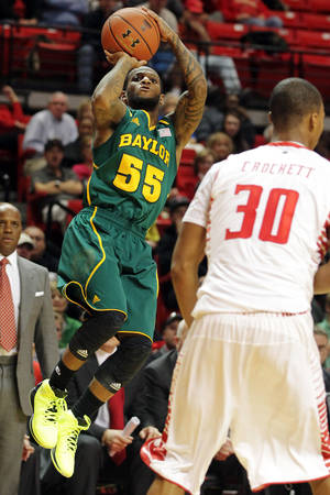 Photo - Baylor's Pierre Jackson (55) shoots over Texas Tech's Jaye Crockett (30) during their NCAA college basketball game in Lubbock, Texas, Tuesday, Jan. 8, 2013. (AP Photo/The Avalanche-Journal, Zach Long) ALL LOCAL TV OUT