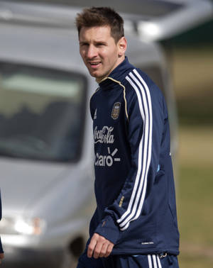 Photo - Argentina's Lionel Messi leaves the field after a training session ahead of their Brazil 2014 World Cup qualifying soccer match against Paraguay, in Buenos Aires, Argentina, Tuesday, Sept. 3, 2013. Argentina will face Paraguay on Sept. 10. (AP Photo/Eduardo Di Baia)