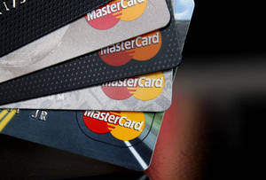 Photo - In this Thursday, April 25, 2013, photo, MasterCard credit cards are displayed for a photographer in Montpelier, Vt. MasterCard Inc. reports quarterly financial results before the market opens on Wednesday, May 1, 2013. (AP Photo/Toby Talbot)
