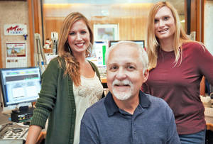 photo - KMGLs radio personalities Jessi Stone, Steve OBrien and Jennifer Leigh, from left, are in the studio Tuesday in Oklahoma City. The station has begun its 24-hour Christmas music programming.  Photo by Chris Landsberger, The Oklahoman