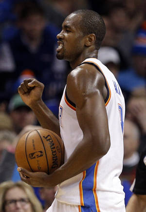 Photo - Oklahoma City's Serge Ibaka (9) reacts to a play during an NBA basketball game between the Oklahoma City Thunder and the Toronto Raptors at Chesapeake Energy Arena in Oklahoma City, Sunday, Dec. 22, 2013. Oklahoma City won 107-95. Photo by Sarah Phipps, The Oklahoman