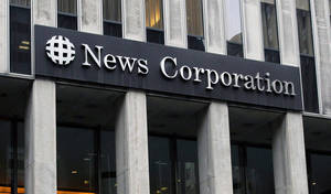 Photo - FILE - In this Oct. 12, 2011, file photo, the News Corporation building is shown in New York. News Corp., said Friday, May 2, 2014, that it has agreed to buy romance novel publisher Harlequin Enterprises from Torstar Corp., for 455 million Canadian dollars ($415 million) in cash. (AP Photo/Kathy Willens, File)