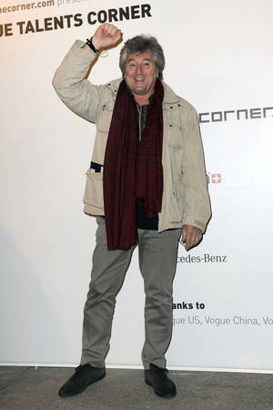 photo - In this photo taken on Feb. 23, 2010, Vittorio Missoni poses for photographers in Milan, Italy. The search resumed Saturday, Jan. 5, 2013 for a small plane that has disappeared off the Venezuelan coast with six people aboard, including Vittorio Missoni, a top executive in Italy's Missoni fashion house, officials said. Vittorio Missoni, 58, is the director general of the iconic brand and the eldest son of the company's founder. Flying with him on Friday's flight from Venezuela's Los Roques resort archipelago to Caracas, was Missoni's wife, Maurizia Castiglioni, two Italian friends of the couple, and a crew of two Venezuelans. (AP Photo/Gian Mattia d'Alberto, Lapresse)