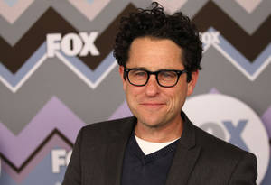 "photo - FILE - In this Jan. 8, 2013 file photo, J.J. Abrams arrives at the Winter TCA Fox All-Star Party at the Langham Huntington Hotel in Pasadena, Calif. According to multiple reports, Abrams is set to direct the next installment of ""Star Wars,"" which Disney has said will be ""Episode 7"" and due out in 2015. Disney bought ""Star Wars"" maker Lucasfilm last month for $4.06 billion.  (Photo by Matt Sayles/Invision/AP, File)"
