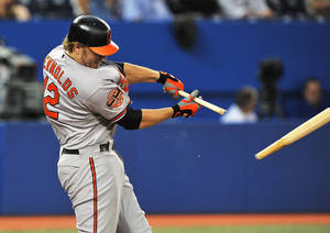 Photo -   Baltimore Orioles' Mark Reynolds breaks his bat hitting a single against the Toronto Blue Jays during the third inning of a baseball game in Toronto, Tuesday, Sept. 4, 2012. (AP Photo/The Canadian Press, Aaron Vincent Elkaim)