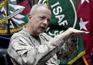 "photo - FILE - This July 22, 2012, file photo shows U.S. Gen. John Allen, top commander of the NATO-led International Security Assistance Forces (ISAF) and U.S. forces in Afghanistan, during an interview with The Associated Press in Kabul, Afghanistan. The Pentagon says Gen. John Allen is under investigation for alleged ""inappropriate communications"" with Jill Kelley, the woman who is said to have received threatening emails from Paula Broadwell, the woman with whom former CIA Director David Petraeus had an extramarital affair. Defense Secretary Leon Panetta says the FBI referred the matter to the Pentagon on Sunday, Nov. 11, 2012. Panetta says he ordered a Pentagon investigation of Allen on Monday. (AP Photo/Musadeq Sadeq, File) ORG XMIT: NY107"