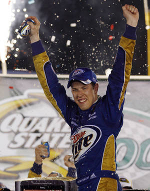 Photo -   Brad Keselowski celebrates after winning the NASCAR Sprint Cup Series auto race at Kentucky Speedway in Sparta, Ky., Saturday, June 30, 2012. (AP Photo/James Crisp)