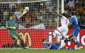 photo -   Italy goalkeeper Gianluigi Buffon saves a shot from England's Glen Johnson during the Euro 2012 soccer championship quarterfinal match between England and Italy in Kiev, Ukraine, Sunday, June 24, 2012. (AP Photo/Kirsty Wigglesworth)