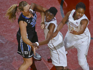 Photo - Florida State forward Natasha Howard, center, tries to throw a pick on Duke guard Tricia Liston (32) in the first half of an NCAA college basketball game, Thursday, Jan. 23, 2014, in Tallahassee, Fla. (AP Photo/Phil Sears)
