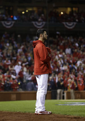Photo - St. Louis Cardinals' Joe Kelly stands outside his dugout long after the national anthem before Game 6 of the National League baseball championship series against the Los Angeles Dodgers, Friday, Oct. 18, 2013, in St. Louis. (AP Photo/Jeff Roberson)