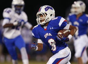 Photo - Christian Heritage Academy's Braden Mikes runs against Millwood during their high school football game at Christian Heritage in Oklahoma City, Friday, Oct. 4, 2013. Photo by Bryan Terry, The Oklahoman