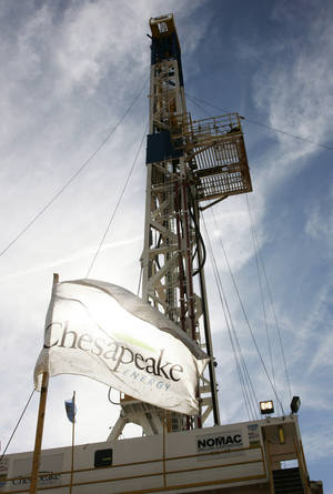 photo - A Chesapeake drilling rig near Bessie is shown.  AP Photo