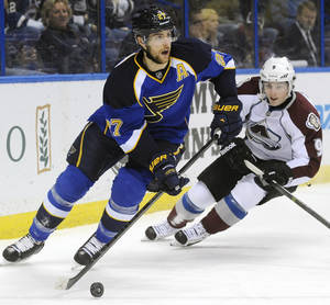 Photo - St. Louis Blues' Alex Pietrangelo (27) controls the puck around Colorado Avalanche's Matt Duchene (9) in the first period of an NHL hockey game Tuesday, April 23, 2013, in St. Louis. (AP Photo/Bill Boyce)