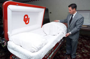 Photo - An OU casket at Resthaven Funeral Home is shown by manager Chad Vice. The Oklahoman Archives