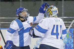 Photo - Jenni Hiirikoski of Finland celebrates their 2-1 win over Germany with goalkeeper Noora Raty after the 2014 Winter Olympics women's ice hockey game at Shayba Arena, Sunday, Feb. 16, 2014, in Sochi, Russia. (AP Photo/Matt Slocum)
