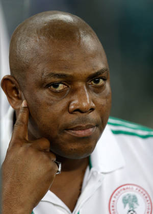 photo - Nigeria&#039;s head coach Stephen Keshi waits for the start of the African Cup of Nations final at the Soccer City Stadium in Johannesburg, South Africa, Sunday, Feb. 10, 2013. Nigeria defeated Burkina Faso 1-0 to take the trophy. (AP Photo/Armando Franca)
