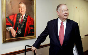 Photo - University of Oklahoma president David Boren stands by a portrait of himself in the hallway outside the room where the OU regents are meeting to discuss conference realignment at the OU Schusterman Campus in Tulsa, OK Sept. 19, 2011. MICHAEL WYKE/Tulsa World ORG XMIT: DTI1109191524423846 KOD