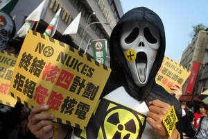 "Photo - A protester holds a slogan reading ""Stop Nuclear Power Plant 4. Refuse Dangerous Nuke"" during an anti-nuclear demonstration in Taipei, Taiwan, Saturday, March 9, 2013. Tens of thousands of Taiwanese have protested to demand that the government scrap a $10 billion nuclear power plant that is nearly complete and slated to begin operating in two years. (AP Photo/Chiang Ying-ying)"