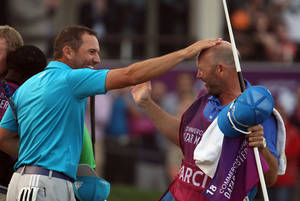 Photo - Sergio Garcia of Spain,Left, celebrates after his eagle putt on the 18th green during the final round of the Commercial Bank Qatar Masters at the Doha Golf Club, on ,Saturday, Jan. 25, 2014. Garcia won the Qatar Masters on Saturday after he birdied the third extra hole to beat Finland's Mikko Ilonen in a playoff. (AP Photo/Osama Faisal)