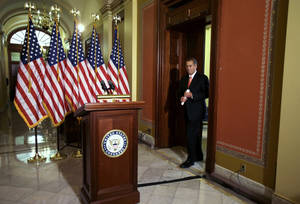 "photo - House Speaker John Boehner of Ohio arrives to speak on the fiscal cliff negotiations on Capitol Hill in Washington, Wednesday, Dec. 19, 2012. Boehner says President Barack Obama should support a Republican plan to avoid January tax increases on everyone but those earning over $1 million. Boehner says if Obama doesn't support the measure, the president will be responsible for what he calls ""the largest tax increase in history.""(AP Photo/Jacquelyn Martin)"