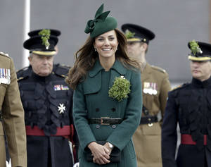 Photo - Kate, The Duchess of Cambridge smiles during a visit to the 1st Battalion Irish Guards at the St. Patrick's Day Parade at Mons Barracks, Aldershot, in England, Monday, March 17, 2014.  The Duke of Cambridge attended the Parade as Colonel of the Regiment. The Duchess of Cambridge presented the traditional sprigs of shamrocks to the Officers and Guardsmen of the Regiment. (AP Photo/Kirsty Wigglesworth)
