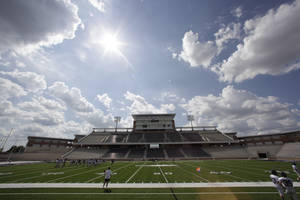 Photo - The sun shines over the  $60 million new football stadium at Allen High School Tuesday, Aug. 28, 2012 in Allen, Texas.  Allen High School northeast of Dallas christens the stadium Friday night with a matchup against defending state champion Southlake Carroll. While other school districts are struggling to retain teachers and keep classroom sizes down, Allen voters approved a $119 million bond issue that pays for the stadium and other district facilities. (AP Photo/LM Otero)