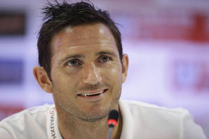 Photo - England national soccer team player Frank Lampard answers a question from a journalist during a press conference after a squad training session that was closed to the media for the 2014 soccer World Cup at the Urca military base in Rio de Janeiro, Brazil, Tuesday, June 17, 2014.  (AP Photo/Matt Dunham)