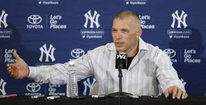 Photo - New York Yankees manager Joe Girardi speaks during a news conference following practice at baseball spring training, Friday, Feb. 14, 2014, in Tampa, Fla. (AP Photo/Charlie Neibergall)