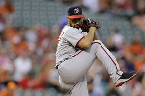 Photo - Washington Nationals starting pitcher Gio Gonzalez winds up for a pitch to the Baltimore Orioles in the first inning of an interleague baseball game, Thursday, July 10, 2014, in Baltimore. (AP Photo/Patrick Semansky)