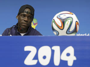 Photo - Italy's Mario Balotelli attends a press conference at Arena Pernambuco stadium in Recife, Brazil, Thursday, June 19, 2014. Italy plays in group D at the soccer World Cup. (AP Photo/Antonio Calanni)