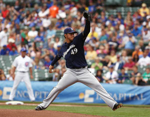 Photo - Milwaukee Brewers starting pitcher Yovani Gallardo pitches to the Chicago Cubs in the first inning in a baseball game in Chicago on Sunday, Sept. 8, 2013. (AP Photo/Charles Cherney)