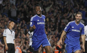 Photo - Chelsea's Mikel, left celebrates after scoring a goal against Fulham during the English Premier League soccer match between Chelsea and Fulham at Stamford Bridge, London, Saturday, Sept. 21, 2013. (AP Photo/Sang Tan)