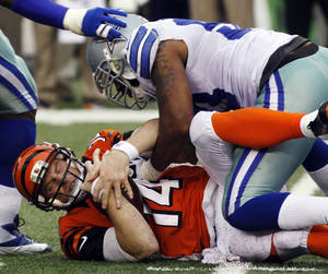 photo - Cincinnati Bengals quarterback Andy Dalton (14) is sacked by Dallas Cowboys outside linebacker Anthony Spencer in the second half of an NFL football game, Sunday, Dec. 9, 2012, in Cincinnati. Dallas won 20-19. (AP Photo/Tom Uhlman)