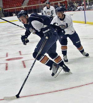 photo - AHL HOCKEY: The Barons' Andrew Lord (12) works out during the opening day of training camp for the Oklahoma City Barons at the Cox Convention Center on Monday, Sept. 26, 2011, in Oklahoma City, Okla. Photo by Chris Landsberger, The Oklahoman  ORG XMIT: KOD