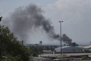 Photo - Smoke rises at the airport outside Donetsk, Ukraine, Monday, May 26, 2014. Ukraine's military launched airstrikes Monday against the separatists who had taken over the airport in the eastern city of Donetsk, suggesting that fighting in the east is far from over. (AP Photo/Ivan Sekretarev)