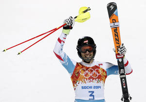 Photo - Austria's Mario Matt celebrates winning the gold medal in the men's slalom at the Sochi 2014 Winter Olympics, Saturday, Feb. 22, 2014, in Krasnaya Polyana, Russia.  (AP Photo/Christophe Ena)