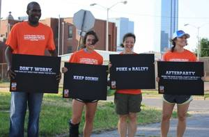 Photo -  Volunteers encourage participants of the Neighborhood Services Organization's 2013 Hungryman Challenge, a 10k run with an edible twist set for Saturday in downtown Oklahoma City.   <strong></strong>