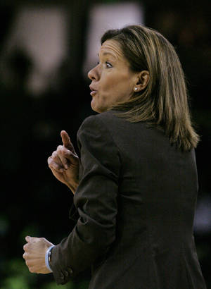 Photo - Missouri's coach Robin Pingeton talks to her players during the first half of their NCAA college basketball game against South Carolina, Sunday Feb. 2, 2014, in Columbia, S.C. (AP Photo/Mary Ann Chastain)