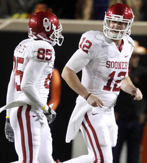 Photo - Oklahoma's Landry Jones (12) and Oklahoma's Ryan Broyles (85) celebrate after a touchdown during the Bedlam college football game between the University of Oklahoma Sooners (OU) and the Oklahoma State University Cowboys (OSU) at Boone Pickens Stadium in Stillwater, Okla., Saturday, Nov. 27, 2010. Photo by Bryan Terry, The Oklahoman